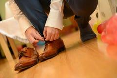 Man tied shoelace Stock Photos