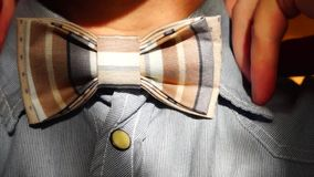 Man ties bow tie stock video footage