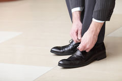 Man Ties His Shoes Royalty Free Stock Images