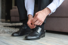 Man ties his shoes. Man's hands tying shoelace of his new shoes Stock Photography