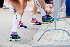 Man ties his sport running shoe before the race. Preparation of sportsman Stock Photography