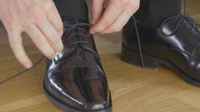 Man that ties shoelaces stock video