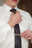 The man ties a tie Stock Images