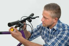 Man Tightening Bolt Of Bicycle Wheel Royalty Free Stock Photos