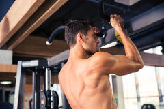Man tightening on horizontal bar Stock Image