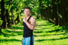 Man tightening up his muscles Stock Photography