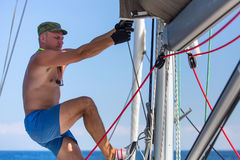 Man tightens the ropes on his sailing yacht. Sport. Royalty Free Stock Image