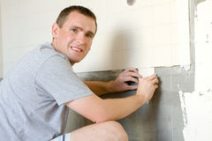 Man Tiling A Wall Royalty Free Stock Photos