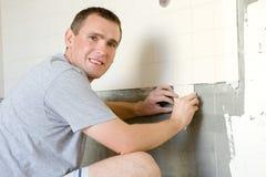 Man Tiling A Wall Royalty Free Stock Photos