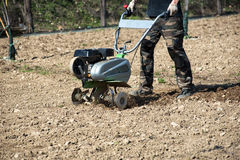 Man tilling or hoeing soil for planting Stock Photography