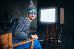 Man in tinfoil helmet and hypnotizing glasses, UFO Stock Photo