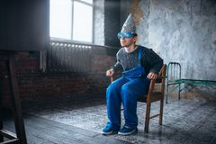 Man in tinfoil helmet and hypnotizing glasses, UFO Royalty Free Stock Photos