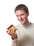 Man with tiny cabin Stock Photo