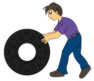 Man with tire Stock Photo