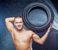 Man with tire Royalty Free Stock Photography