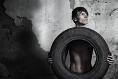 Man with tire Royalty Free Stock Image