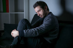 Man tired and depressed lying Royalty Free Stock Photos