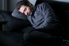 Man tired and depressed lying stock photography