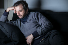 Man tired and depressed lying Stock Images