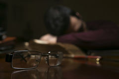 Man tired after reading. Man sleepy after doing some reading Stock Photos