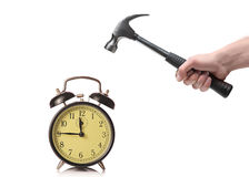 A man about to break an old clock Royalty Free Stock Images
