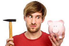 Man about to break a piggybank Stock Image