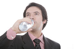 Man to drink water, in deep wh. Man with fact and necktie to drink water, in deep white Stock Images