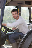 Man about to drive tractor Stock Photos