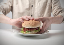 Man about to eat a hamburger Stock Images