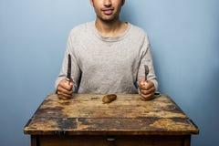 Man about to eat sausage Royalty Free Stock Image