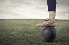Man about to kick the ball Stock Photo