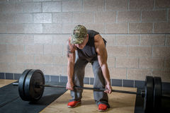 Man about to perform deadlift Royalty Free Stock Image