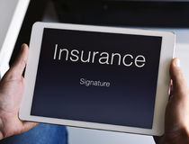 Man about to sign an insurance policy. Closeup of a young caucasian man about to sign an insurance policy in a digital tablet Royalty Free Stock Photos