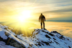 The man to stand on mountain top at sunrise Royalty Free Stock Photos