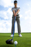 Man about to strike golf ball, low angle view Royalty Free Stock Photography