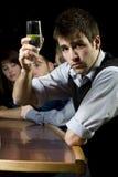 Man toasting at bar Royalty Free Stock Images