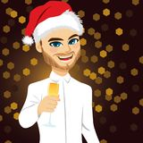 Man Toasting Christmas. Young business man with white shirt and Santa hat toasting with champagne glass on Christmas day Stock Images