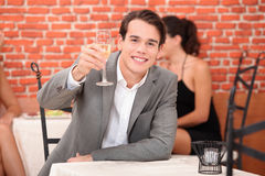 Man toasting with glass Royalty Free Stock Photo