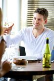 Man Toasting with a Glass of Wine Royalty Free Stock Image