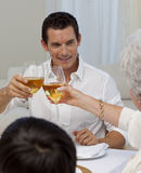 Man toasting with his mother in a Christmas dinner Royalty Free Stock Image