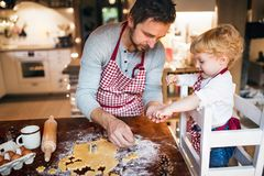Young family making cookies at home. Royalty Free Stock Photos