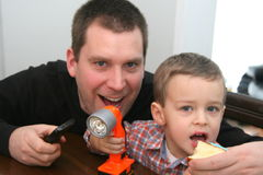 Man and toddler making faces Royalty Free Stock Images