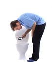 Man and toilet Royalty Free Stock Photography