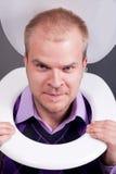 Man in toilet Stock Image