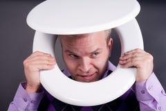 Man in toilet Stock Photo