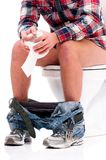 Man on toilet bowl Royalty Free Stock Photos