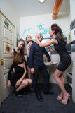 Man in toilet with drunk women Stock Photo