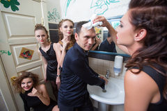 Man in toilet with drunk women Stock Image