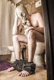 Man on the toilet. A man on the toilet with a gas mask Royalty Free Stock Photos
