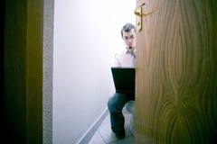 Man On Toilet with Laptop Stock Photos
